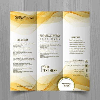 Leaflet with yellow wavy shapes