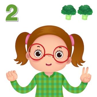 숫자 2를 보여주는 아이 손으로 숫자를 배우고 세기