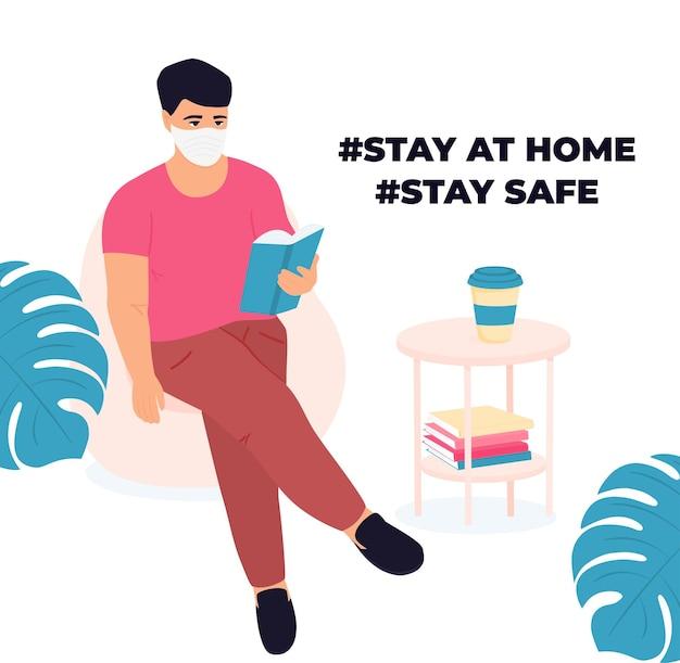 집에서 배우기. 남자는 책을 읽고 있습니다. 코로나바이러스 covid-19 동안 격리. 자가 격리. 시험을 준비하는 남자.