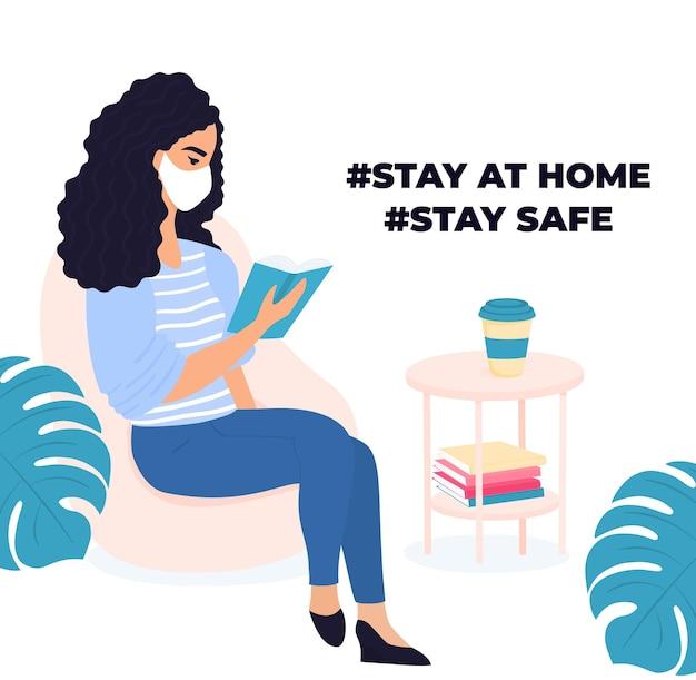 집에서 배우기. 여자는 책을 읽고 있습니다. 코로나바이러스 covid-19 동안 격리. 자가 격리. 시험을 준비하는 소녀.