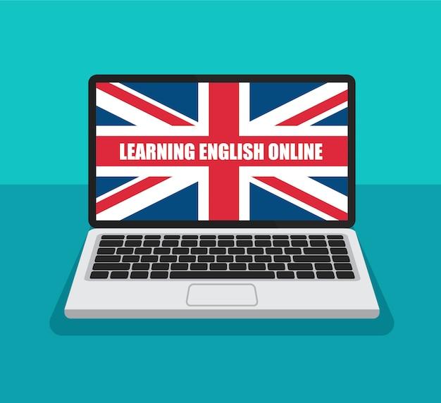 オンラインで英語を学ぶ。トレンディなフラットスタイルのラップトップディスプレイ上のイギリスの旗。夏の英語コースのコンセプトです。