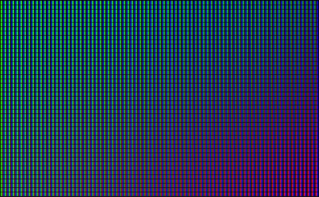 Led wall video screen with green, blue and red dot lights on black background.