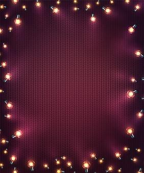 クリスマスライトとクリスマスの背景。ニットテクスチャ上のled電球の休日輝く花輪