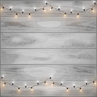 木製の背景にメリークリスマスの光沢のあるledライト