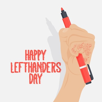 Left handers day with hand holding pen
