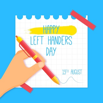 Left handers day with hand and pen