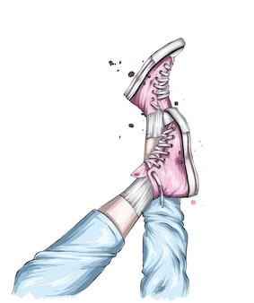 スタイリッシュなスニーカーとジーンズの脚