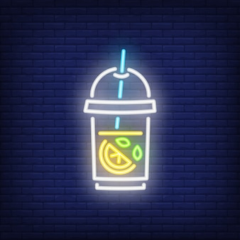 Lemonade neon sign. glass of iced tea with lemon on dark brick wall background.