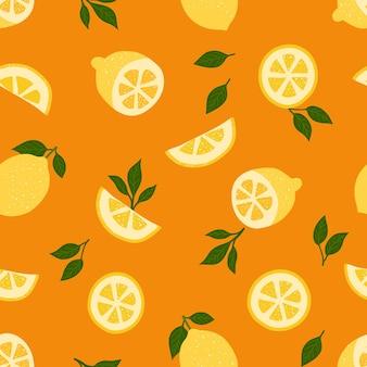 レモンのトロピカルフルーツとオレンジ色のシームレスなパターンの葉
