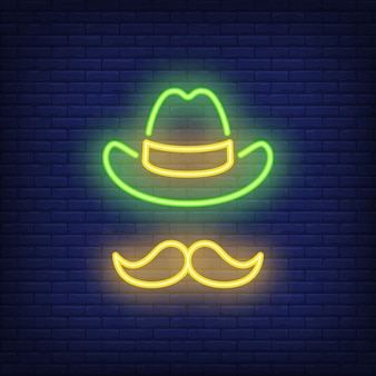 Leprechaun hat and moustaches for st. patricks day on brick background.