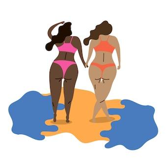 다른 국적의 레즈비언들이 손을 잡고 바다를 걷다 lgbt 여행에 영감을 줍니다
