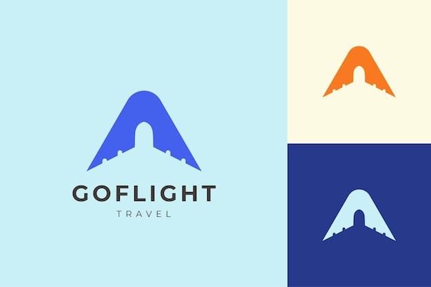 文字シンプルでクリーンな飛行機の形をしたロゴ