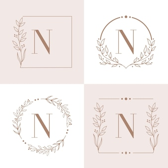 Letter n logo with floral frame background template