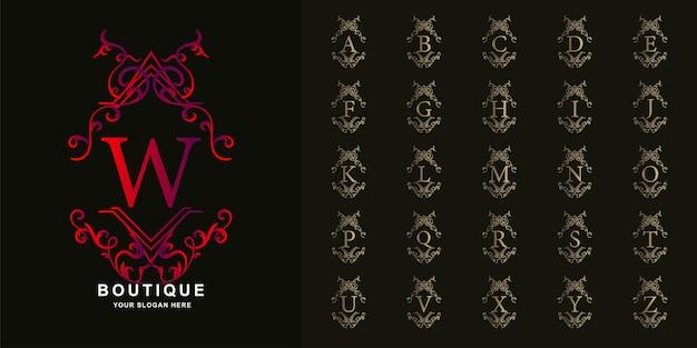 文字wまたは豪華な飾り花フレームゴールデンロゴテンプレートとコレクションの最初のアルファベット。 Premiumベクター