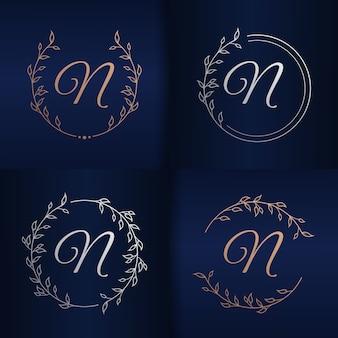 花のフレームのロゴのテンプレートと手紙