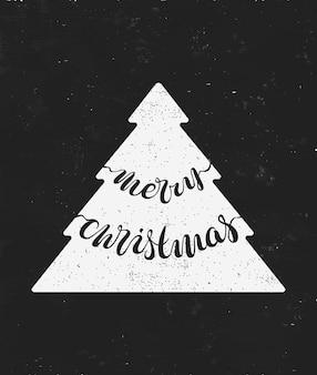 クリスマスのレタリング、傷のある効果のある手書きのグリーティングカード、クリスマスツリー、「メリークリスマス」という言葉。