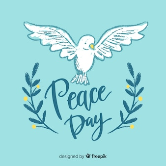 Lettering peace day background with dove