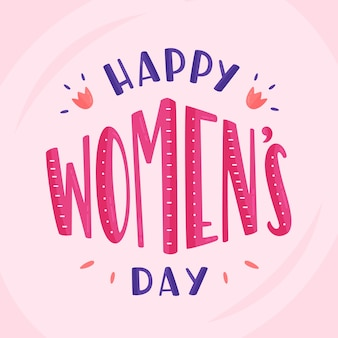Lettering women's day on pink background