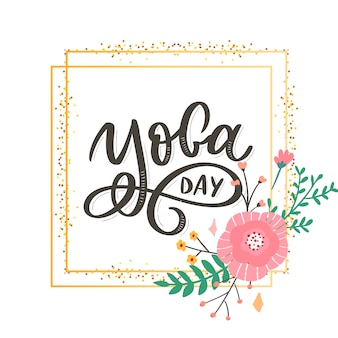 Lettering yoga day with golden frame and flower