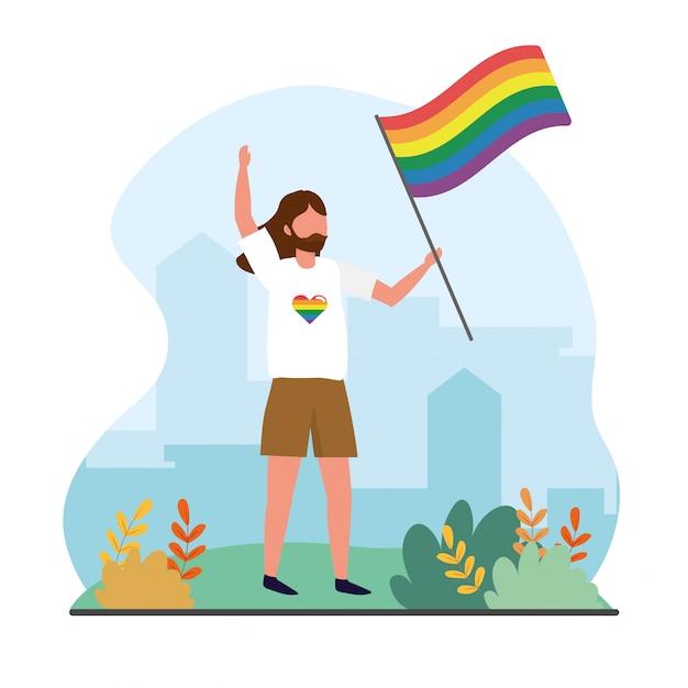 Lgbtの自由に虹色の旗を持つ男