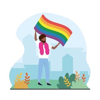 誇りに思うlgbtに虹色の旗を持つ男