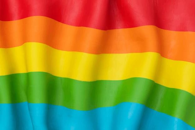 Vettore di sfondo bandiera arcobaleno lgbtq+ in texture argilla plastilina fai da te
