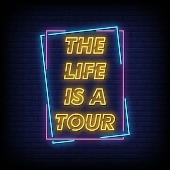 The life is a tour neon signboard on brick wall