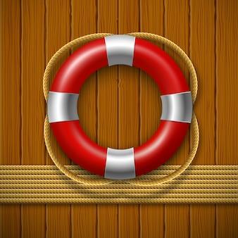 Спасательный круг на деревянной стене