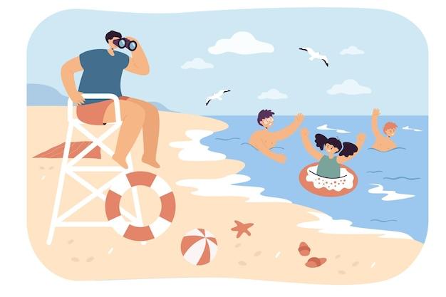 해변에서 수영하는 아이들을 돌보는 인명 구조원