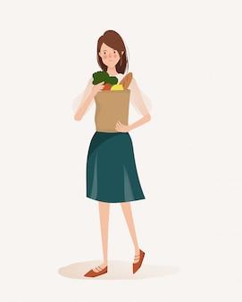 ライフスタイル手描きのいくつかの有機食品を買う若い女性。