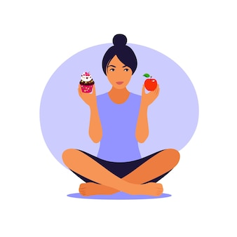Lifestyle and nutrition concept. woman choosing between healthy meal and unhealthy food.