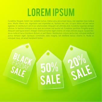 Concetto di vendita pubblicitaria leggera con iscrizioni di cartellini dei prezzi in vetro e tassi percentuali sul verde.