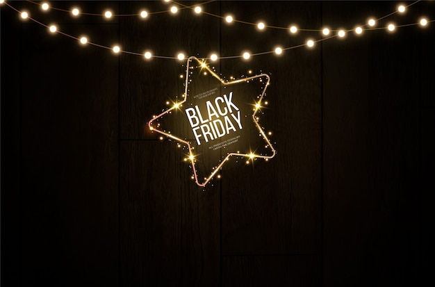 Light banner of black friday in the forem of glowing stars hanging on a golden luminous lamp.