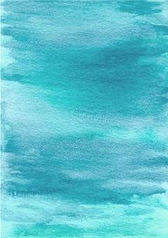 水彩で水色の抽象的なテクスチャ背景