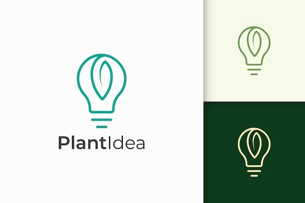 단순하고 현대적인 스타일의 전구 및 잎 로고는 기술 아이디어를 나타냅니다.
