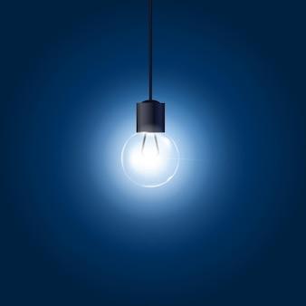 青い背景のコードにぶら下がっている電球