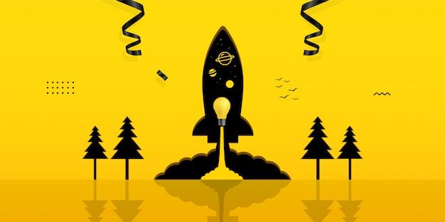 黄色の背景のロケットの穴の中に電球を起動