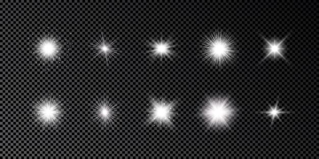 Световой эффект бликов линз. набор из десяти белых светящихся огней с эффектами звездообразования с блестками на темном прозрачном фоне. векторная иллюстрация