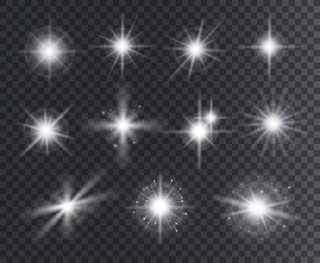 光の効果。白い星が火花を散らし、光線で明るいフレア。魔法の光るほこりの粒子。クリスマスの抽象的な要素の分離セット。
