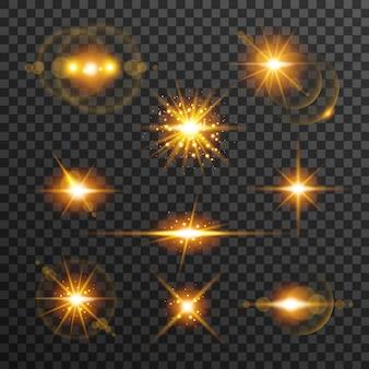 光フレアは、透明な背景に分離された黄金色に設定。太陽光線、輝く星、グロー効果で輝き、