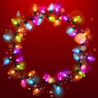 Light garland ring on red background.