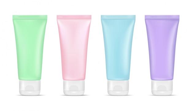 밝은 녹색, 분홍색, 파랑 및 자주색 크림 튜브 흰색 배경에 고립. 3d 플라스틱 화장품 용기.