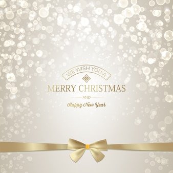 Light happy new year and christmas greeting card with golden inscription and ribbon bow