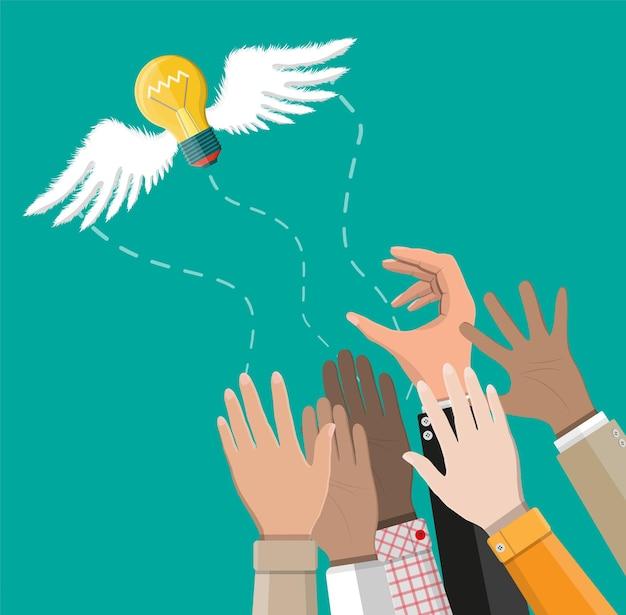 ビジネスマンの手から離れて飛んで翼を持つライトアイデア電球。創造的なアイデアやインスピレーションの概念。フラットスタイルのスパイラルとフライングガラス電球。ベクトルイラスト