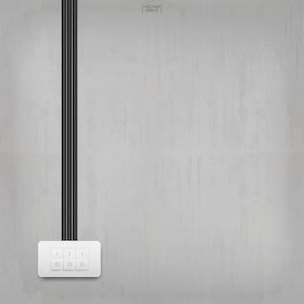 Выключатель света на фоне бетонной стены