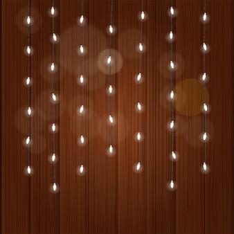 화려한 배경에 조명 화환 그림입니다. 나무 벽에 빛나는 램프