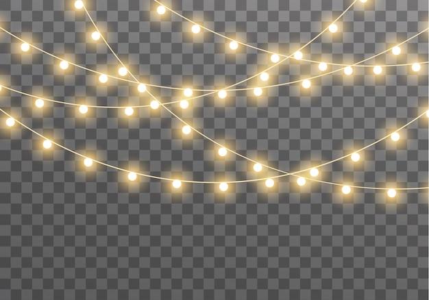 カード、バナー、ポスター、webデザインの透明な背景に分離されたライト。黄金のクリスマス輝くガーランドのセットは、ネオンランプの図を導いた。