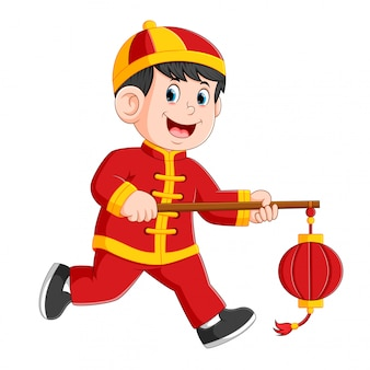 A liitle boy is running and holding the chines paper latent
