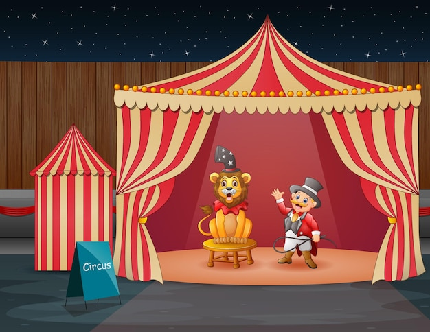 A lion circus with trainer performing on the circus tent