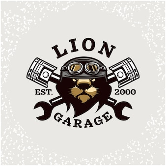 ライオンヘッドの自動車修理とカスタムガレージのロゴ。